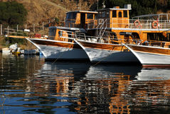 Three Boats In The Harbor. Three boats moored in the harbor in Turkey Royalty Free Stock Photography