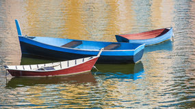 Three Boats in Harbor Stock Images