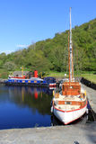 Three boats moored in basin, Crinan Canal Scotland. Three different types of boat moored in the basin at the western end of the Crinan Canal, Argyll and Bute Royalty Free Stock Images