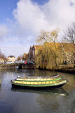 Three boats moored on a canal Royalty Free Stock Image