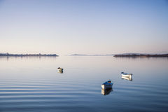 Three boats on peaceful lake Royalty Free Stock Photography
