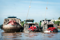 Three boats with red prow Stock Photos