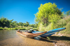 Three boats were tied up in the river. With blue sky background Stock Photo