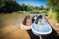 Three boats were tied up in the river. With blue sky background Stock Image