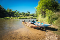 Three boats were tied up in the river. With blue sky background Royalty Free Stock Images