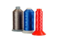 Three bobbins of  thread Royalty Free Stock Images