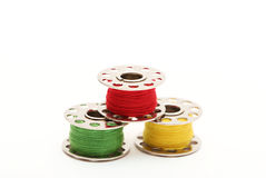 Three Bobbins Stock Photography