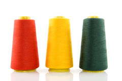 Three bobbins with threads royalty free stock images