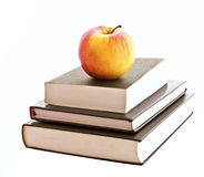 Three books and apple isolated Royalty Free Stock Photography
