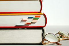 Three books and glasses Royalty Free Stock Photo