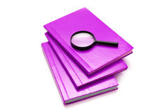 Three books and magnifying glass isolated Stock Photo