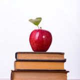 Three books and red apple Stock Image