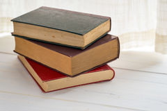 Three books. On the sill of a window. Copy space Royalty Free Stock Image