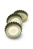 Three bottle caps Stock Photos