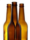 Three bottles. Three empty beer bottles isolated over white background royalty free stock image