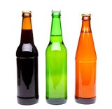 Three bottles of beer. Close-up on the white background Stock Photography