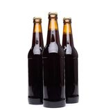 Three bottles of beer on white background. Three bottles of beer  on white background Stock Images