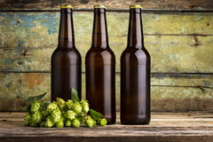 Three bottles of beer on wooden background Stock Photo