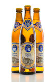 Three bottles cold light lager beer Bavarian Hofbrau Munich brew. Munich, Germany - June 11, 2016: The three bottles of cold light original lager beer from Stock Photo