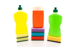 Three bottles of detergent and sponges Royalty Free Stock Photos