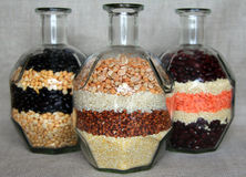 Three bottles with different cereals Stock Images