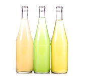 Three bottles of fresh lemonade. On white background Royalty Free Stock Photo