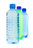 Three bottles full of water Stock Image