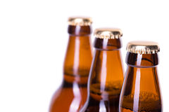 Three bottles of ice cold beer isolated on white Royalty Free Stock Image