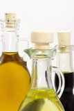 Three bottles with oil Stock Images