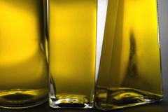 Three bottles of oil Stock Images