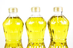 Three bottles oil of refined palm olein from pericarp Stock Photos