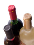 Three bottles of red and white wine stock images