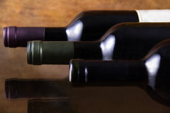 Three bottles of red wine Stock Images