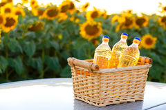 Three bottles of sunflower oil in a wicker basket Royalty Free Stock Photos