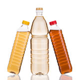 Three bottles of vinegar. Royalty Free Stock Images