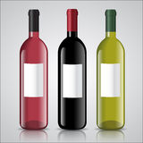 Three bottles of white and red wine with labels Stock Images