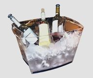Three bottles of wine in a glass box with ice royalty free stock photo