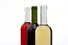 Three bottles of wine in a row. Royalty Free Stock Photo
