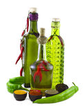 Three Bottles With Green Pepper Royalty Free Stock Photography