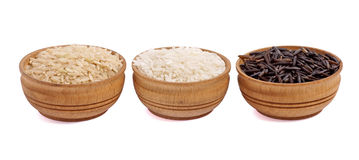 Three bowl of rice. White, black and brown rice isolated on white background royalty free stock images