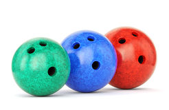 Three bowling balls. Green, blue and red bowling balls with marble texture isolated on white background. 3D illustration Stock Photo