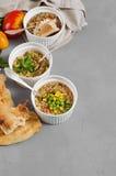 Three bowls of bean, quinoa soup and mushroom bulgur on a gray b Royalty Free Stock Photos
