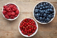 Three bowls of berries Stock Photos