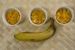 Three bowls with breakfast cereals and banana Royalty Free Stock Photo