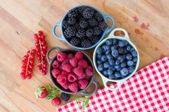 Three bowls of fresh raspberry Stock Photo