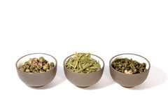 Three bowls of herbal tea. Close-up, isolated on white Royalty Free Stock Photo