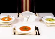 Three bowls of hot vegetable soup served at table Royalty Free Stock Photography