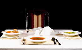Three bowls of hot vegetable soup served at table Royalty Free Stock Images