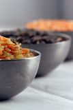 Three bowls of lentil Stock Photos