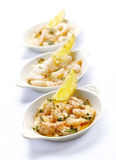 Three bowls with prawns and garlic butter Royalty Free Stock Image